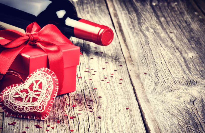 bottle of wine, red gift box and a plush heart