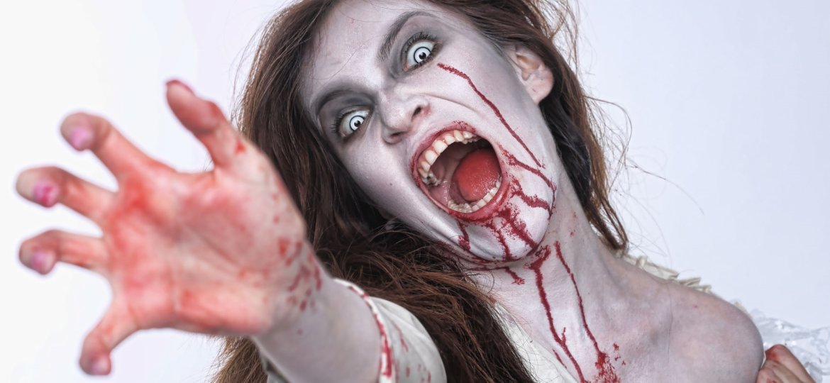bleeding psychotic woman in a horror themed image