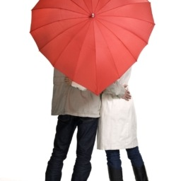 Couple under heart-shaped umbrella