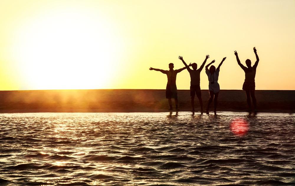 silhouette of people enjoying fun on the beach.
