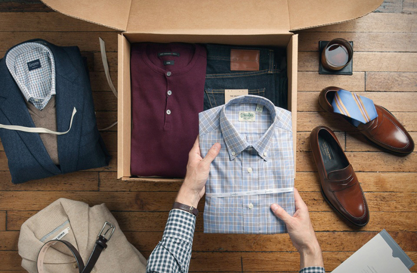 man putting neatly folded dress shirt into drawer