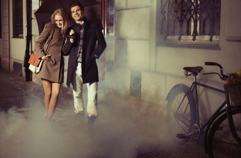 woman and man walking down urban street wearing spring clothes