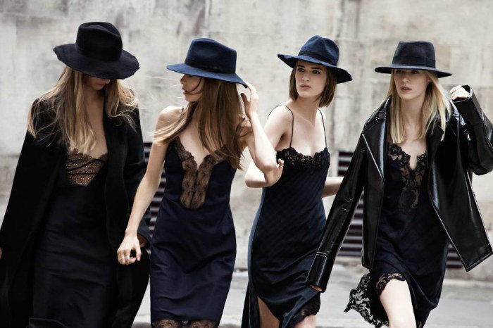 Four women in slip dresses with top hats