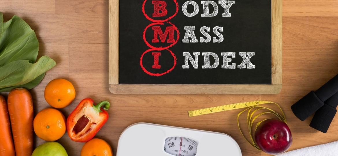 top view, fitness and weight loss concept, dumbbells, white scale, towels, fruit, bmi body mass index formula rate formula in a board