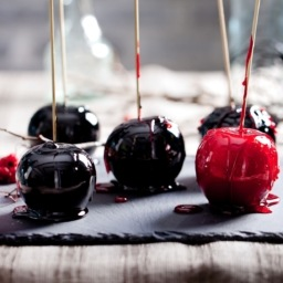 Poison Candy Apples sitting on a baking mat